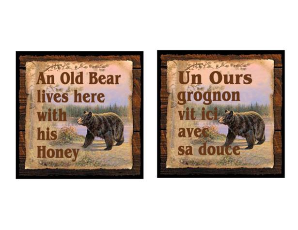 Un ours grognon vit ici avec sa douce